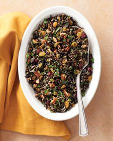 Wild rice,pecans & dried cranberries pilaf // 2 T olive oil 1/4 c shallot, diced 1 c wild rice 2 c chicken stock 1/2 c pecans, toasted 1/4 c dried cranberries 1/4 c golden raisins, chopped 2 T chopped flat-leaf parsley Salt & pepper Cook onions, add rice cook 1 more min., add stock & cook/simmer for 40 min. Add the rest & mix well.