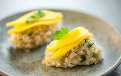 Mango-Crab Sushi // With flecks of savory crab and green onions in the brown rice, these nigiri-style sushi bites are perfectly topped with juicy, sweet slices of mango. Makes a great lunch or dinner!