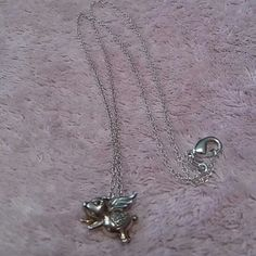 """When Pigs Fly Sterling .925 Necklace & Pendant .925 Sterling Silver 18"""" Chain with .925 Sterling Silver & Pink Color Sterling Pig with Wings Pendant.  Has 4 tiny diamonds on the heart on its booty.  Very adorable.  Material: .925 Sterling Silver  Color: Silver & Pink Sterling  Condition: Excellent Pre-loved Condition Jewelry Necklaces"""