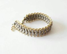 Check out this item in my Etsy shop https://www.etsy.com/listing/256141773/faux-suede-gold-chain-bracelet-golden