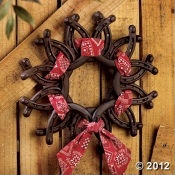 horse shoe wreath..!! This would be so cute in a boys western theme room. SO many possibilities for this.