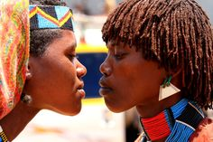 Hamer Women kiss Photo by Arie Chen — National Geographic Your Shot