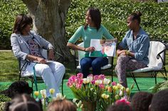 First Lady Michelle Obama watches daughters Malia & Sasha read to kids at the 2013 White House Easter Egg Roll, April 1, 2013.