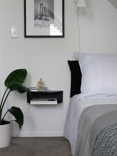 Making your guests feel welcome is more than just being a good host. give them a beautiful room to sleep in and they will keep coming back for more. Bedside Shelf, Wall Paint Colors, Wall Treatments, Floating Nightstand, Guest Room, Shelves, Bedroom, Table, House