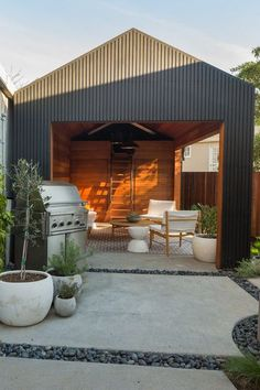 Awkwardly shaped and saddled with a run-down garage, the backyard posed a challenge. Since the city wouldn't allow for the removal of the garage, Wendi and Lukas decided to convert it into additional living space.