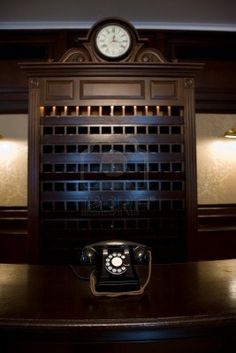 old vintage hotel lobby desk with telephone and clock and key shelf Stock Photo - 3605942