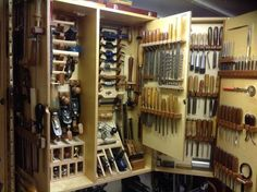 Wall Tool Cabinet with fold-out hinged leaves, fold-out backs of doors, cubbies, horizontal slots
