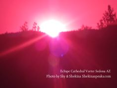 """""""Solar eclispe at Cathedral Rock vortex Sedona AZ 2012"""" it shows the download of the Rose Ray, its amazing how the whole picture is this intense rose color, I feel it the Divine showing us in physcial form"""