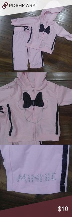 Minnie mouse jogging suit Sweet pink sweatsuit with black satin side stripe on both pants and sweatshirt. Satin bow and silver sparkle detail. Size 3-6 months and in great condition Disney Matching Sets