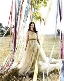 Ambiance~  Ribbons hanging from an arch or a tree creates a lovely motion at outdoor wedding~  (Photo Credit: intimateweddings.com)  (410) 819-0046  www.maryannjudy.com