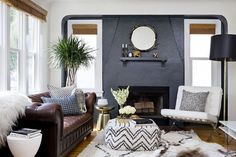 Monochrome living space with a gray contrast wall and a leather sofa