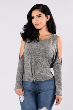 - Available in Rust and Heather Grey - Soft Sweater Top - Round Neckline - Long Sleeve - Cold Shoulder - Knot Front - Made in USA - 85% Polyester 10% Rayon 5% Spandex