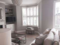 Sitting Room. Farrow and Ball Cornforth White walls. Loaf rug and coffee table.