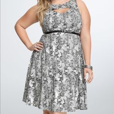 NWT torrid size 16 lace print retro swing dress NWT torrid size 16 lace print retro swing dress. This adorable dress has wide straps and a peekaboo front . Plenty of room and stretch for a larger bust . Belt is included torrid Dresses
