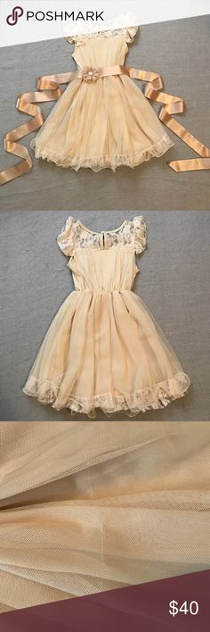 Flower girl dress Adorable vintage/ country feel custom made flower girl dresses. Vintage cream/tan color with lace detail and detached satin flower belt. 2 available- one approx size M in perfect condition and one approx size S in almost perfect condition (small snag on front - see pic) Dresses