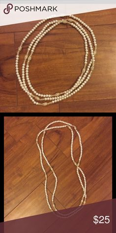 Long hanging strand of pearls with jewel details This was a gift I don't know if it's real or faux Jewelry Necklaces