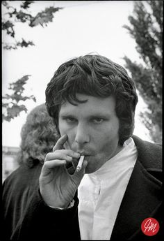 Jim Morrison smoking 1968. He could be little brother of Freddie Mercury. Photo by Jim Marshall.