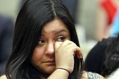 Myrna Orozco, 22, of Kansas City, Mo., an illegal immigrant originally from Mexico, wipes away tears while watching President Obama announce that the U.S. government will stop deporting and begin granting work permits to younger illegal immigrants who came to the U.S. as children and have since led law-abiding lives, Friday, June 15, 2102, in Washington