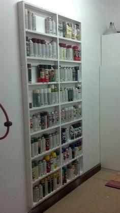 Spray can storage.