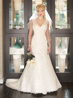 This beautiful gown features lace and tulle over English netting with beaded detail. The V-neck, sweetheart top and plunging neckline give a modest, but finished look!