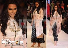 Neha Dhupia walked the ramp in a black printed skirt teamed with a long white kurta and nude pumps. Oh-so-boho!