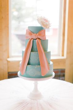 Blue wedding cake with a pink bow: http://www.stylemepretty.com/2014/04/09/romantic-garden-party-style-wedding/ | Photography: Brumley and Wells - http://brumleyandwells.com/
