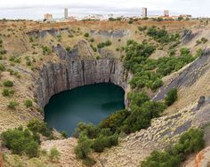 The Big Hole in Kimberley, Northern Cape. Kimberley developed around this huge hole in the ground, formerly a small hill known as Colesberg Koppie, . Earth From Space, My Land, Amazing Destinations, Abandoned Places, Continents, Great Places, South Africa, Travel Photography, Stock Photos