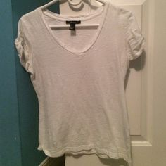 white v-neck A white basic v-neck from F21 never wore has some cute buttons on the side Forever 21 Tops Tees - Short Sleeve