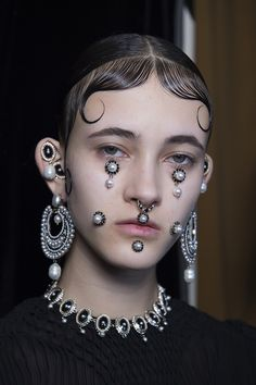 """Chola Victorian"" was the unusual combination of words Pat McGrath used to describe the incredibly ornate look at Givenchy complete with piercings and face bijoux."