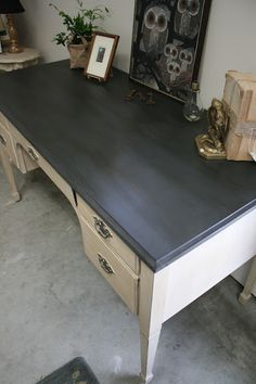 Spray painted graphite chalk board paint.... BUT... Dark waxed afterwards! Gives a solid slate kind of look.