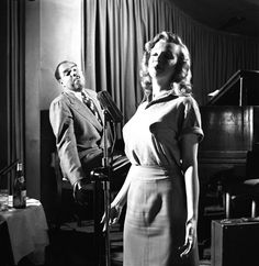 Marilyn taking singing lessons with bandleader Phil Moore in 1949. Photo by J.R.Eyerman.