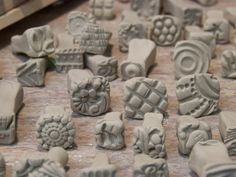 Old buttons, textures, create stamp designs for impressions on clay.