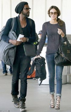 Nicole Trunfio and her boyfriend Gary Clarke Jr... travel style in lace up heels!