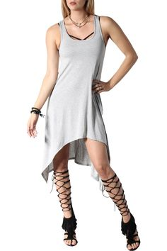 Thisdress with aflowy bottom, features sides that are little longer. A high front and lower back. Perfect for every day. Dinner, brunch or night out in the city. Dress it up and down as you want.   Grey Freedom Dress by Rock Etiquette. Clothing - Dresses - Casual California