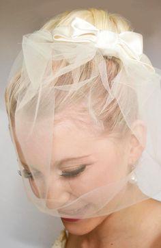 http://www.bridalknot.co.uk/bridal-birdcage-veil-with-a-satin-silk-bow-wedding-veil-4343-p.asp