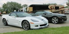 A 45th-anniversary Chevrolet Camaro SS and 60th-anniversary Corvette 427 convertible wait for the Detroit Grand Prix weekend on Belle Isle. Photo by Autoweek.