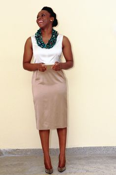 Closet Diaries: Chimamanda Ngozi Adichie. White blouse, beige pencil skirt, emerald bib necklace.