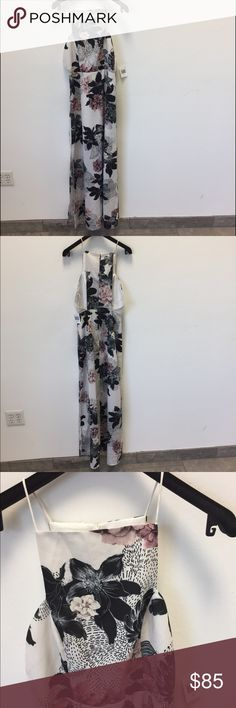 Finders Keepers Floral Maxi dress size XS new Finders Keepers Floral Maxi dress size XS new with tags .. please note there is a small blemish towards the back of the dress see picture and also one of the straps was coming a little un- done so I had it fixed the dress  is so gorgeous Bd perfect for spring and summer Finders Keepers Dresses Maxi