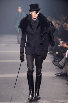 """clintcatalyst: English Man: Thierry Mugler [ Collection Hommes Hiver, 2010 ] """"To be fair, he will not say that a black body is a system absorbing all the light it receives. Yet he wears black in an inimitable way: in a two-fabric jacket, smocked shirt and stretch cotton trousers. Cultivating the art of detail with care, he has the English genius for excess. With him, fur, eye patch, cane and hat become discreet add-ons."""""""