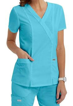 BEAUTIFUL AND BALANCEDThis is one of our best-selling tops, and it's easy to see why: good looks, great fit, and guaranteed performance add up to a scrub top that can't be beat. Princess seams outline and accentuate, while back elastic and center slits add flair and a bit of sass. Grey's Anatomy 2 Pocket Crossover Scrub Tops V-neck Princess seams Center slits Back elastic Two pockets 77% polyester/ 23% rayon Medium center back length: 26 1/2