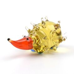 """""""Small #Hedgehog Glass Figurine Item No. GF00323A01 $10.49 This glass figurine is hand blown and imported from #Russia. It's bright colors and adorable shape is sure to delight! Because each figurine is crafted by hand no two are exactly alike."""" Blown Glass Art, Glass Figurines, Halloween Ghosts, Colored Glass, Bright Colors, Hedgehog, Russia, Miniatures, Shapes"""