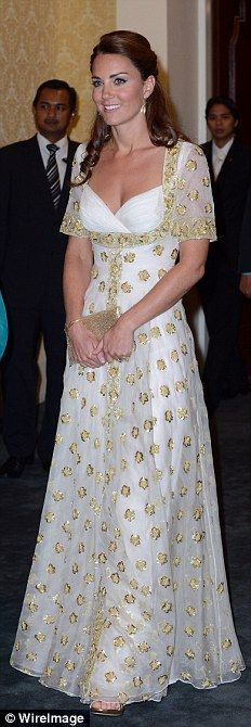 ALEXANDER MCQUEEN, £5,000: Later in the evening she changed into this stunning bespoke gown carrying a £180 Wilbur and Gussie gold clutch