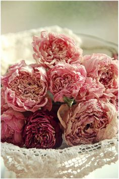 Peonie petals echo the soft ruffled texture so prominent in shabby chic decor (think curtains, bed linens, etc.)
