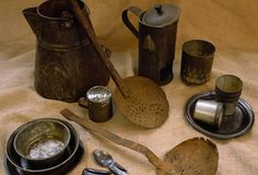 Camp Artifacts: Civil War camp objects include a coffee boiler, ladles, mess plates, a salt or sugar shaker, a combination knife-fork-spoon, tin cups, and a coffee bean roaster. (Photo Credit: Tria Giovan/CORBIS)