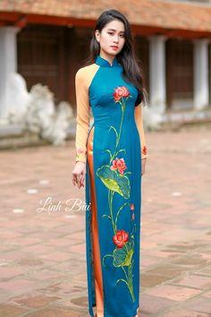 Tên sản phẩm: Áo dài truyền thống  Màu sắc: Xanh cam  Chất liệu: Lụa cao cấp co dãn 4x  Hotline: 092.888.6989 – 0988.992.590