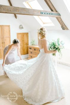 Sassi Holford floral patterned strapless traditional wedding dress for an elegant farmhouse wedding in Nottinghamshire, UK. Dress from luxury bridal boutique Courtyard Bridal Boutique.