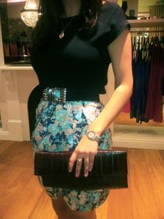 A nice top with a lovely patten dress with a matching clutch ( purse)