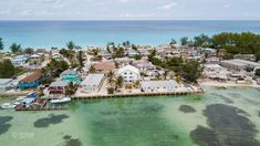 Our place from the air. Look for 3 storey white house. #Bimini is a tiny sandbar. Which beach you want to swim in?  #bestplaceswimwilddolphin #wilddolphin #relax #onelove