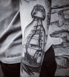 Sketched ship in a bottle tattoo