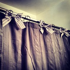 Bows on the shower hooks to dress up a plain shower.  curtain. JUST did this in MY bathroom upstairs with silky white bows. BloGging it!